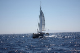 Catamaran Pluto sailing in the ionian sea