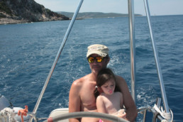 Father and Daughter at the helm of Pluto catamaran