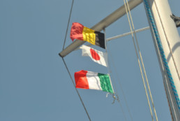 Belgium, Japanese and Italien Flag at the Mast