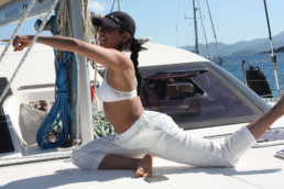 Yoga on deck of catamaran Pluto
